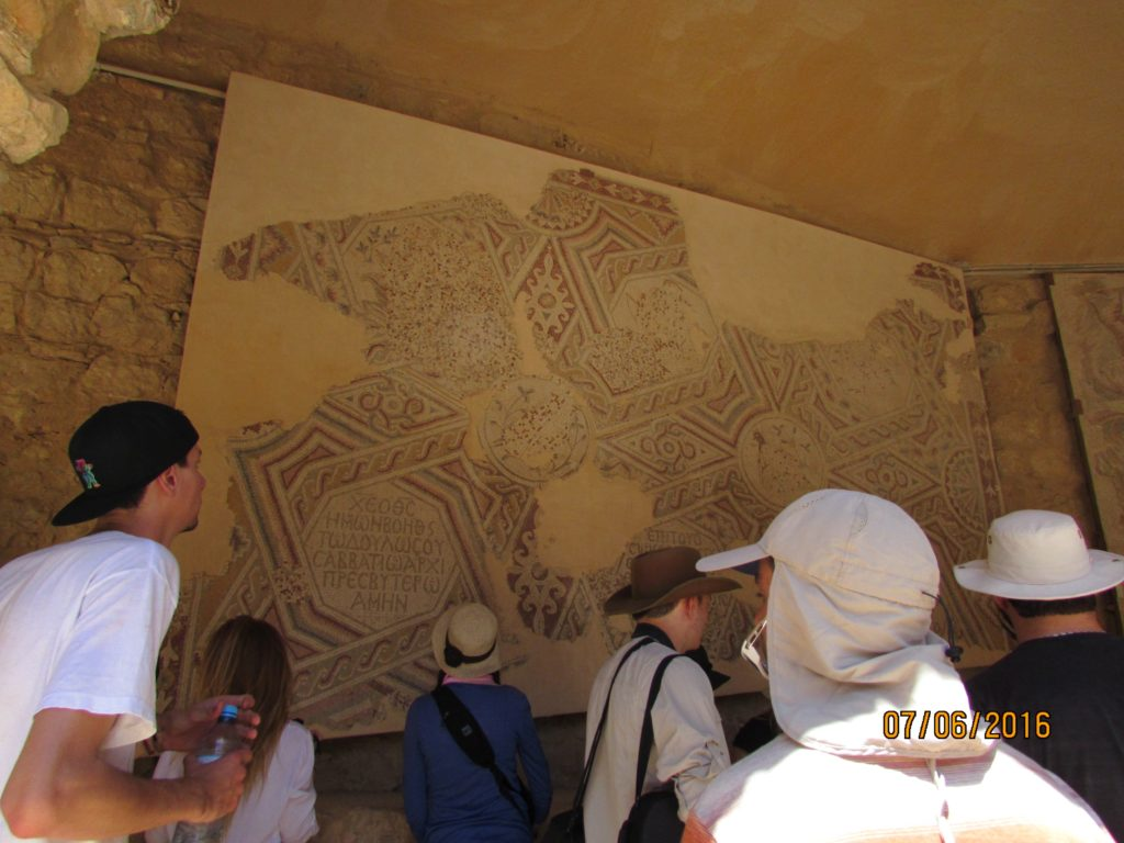 Students taking in one of Madaba's many mosaics as part of the Walking Tour that kicks off the 2016 season at the Town of Nebo Project